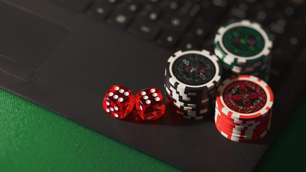 poker chips and dice on a keyboard for starting a new online casino